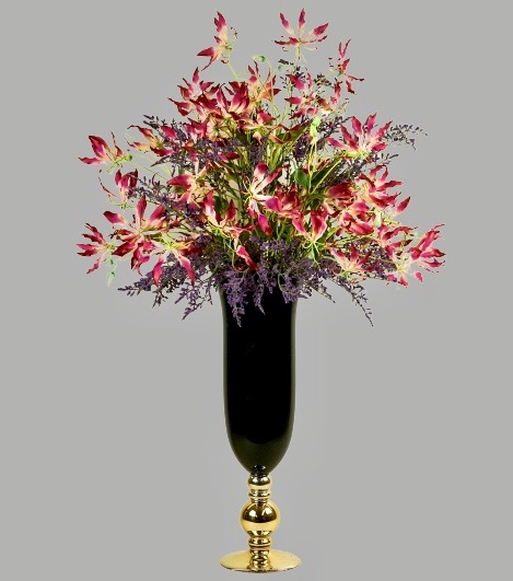 Gloriosa in black vase