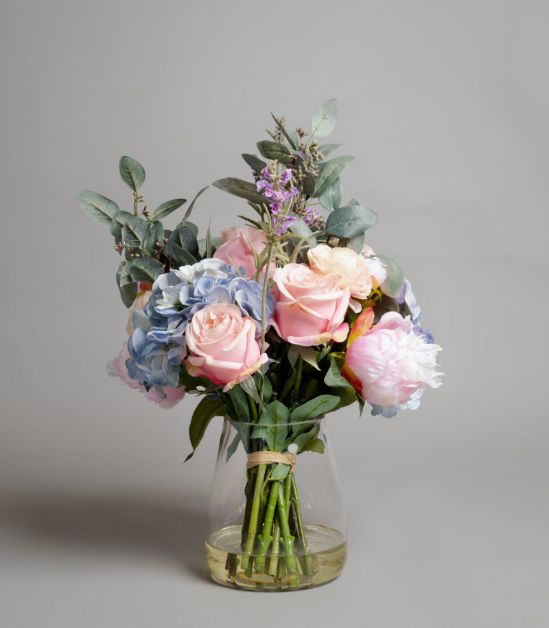 Pink and blue hydrangeas in vase