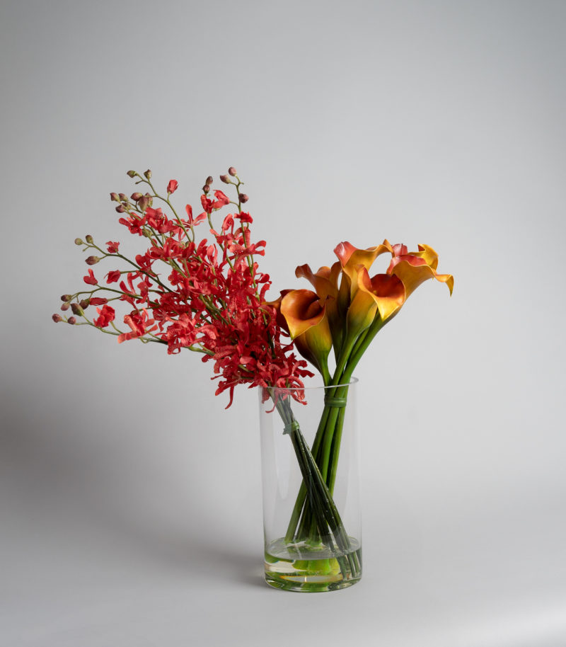 Artificial flower arrangement with calla lily