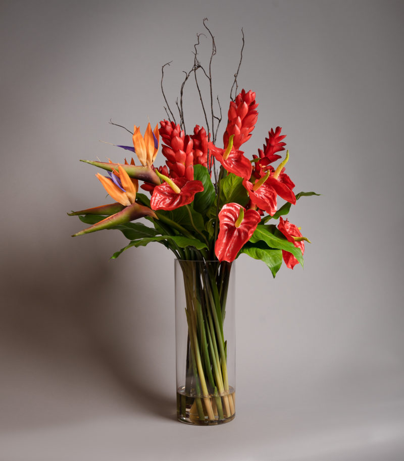 Artificial flower arrangement with birds of paradise