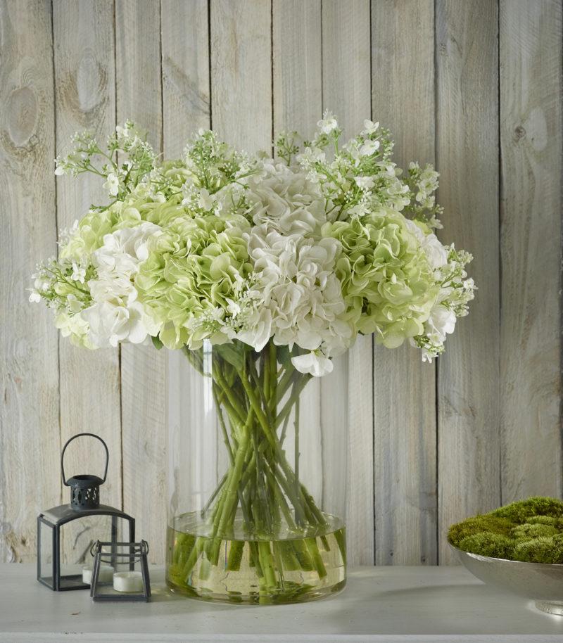 Artificial hydrangeas in glass vase