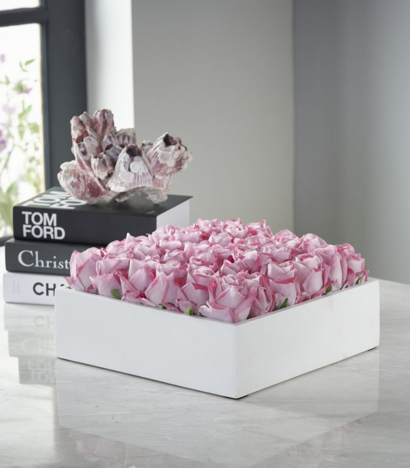 Artificial roses in white vase